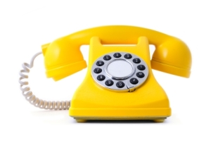 yellow painted classical style phone on white